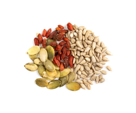 Healthy grains mix with sunflower, pumpkin seeds and dry goji berries isolated on white background top view