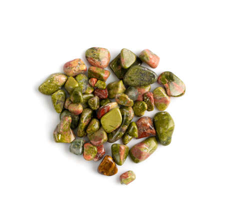 Unakite pebbles isolated. Brown polished altered granite stones with pink orthoclase feldspar, green epidote and quartz top view Stock Photo