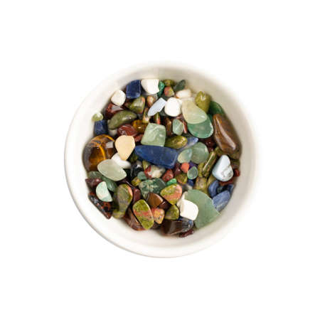 Colorful semiprecious stones mix isolated. Green, red, blue, white, black and purple quartz pebbles top view