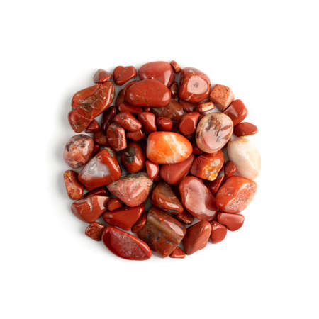Jasper pebbles isolated. Red sardonyx polished stones, raw orange onyx pebble set, jasper gemstones, carnelian cabochons top view