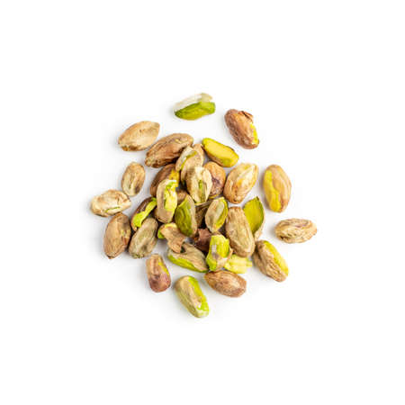 Fried peeled pistachio nuts isolated. Baked pistachios pile, salt pistache on white background top view