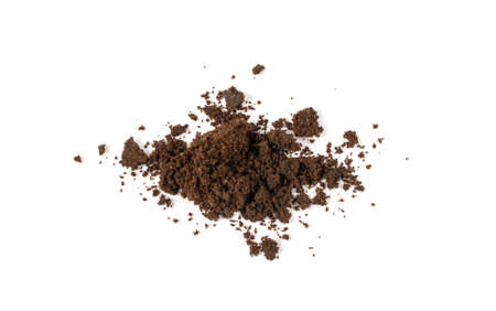 Heap of used grinding coffee waste isolated. Pressed coffee for scrub, eco bio waste on white background Stockfoto