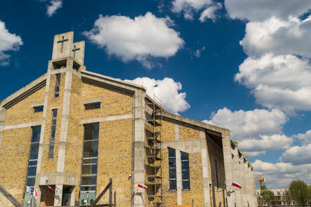Modern catholic church under construction in Warsaw, editorial image view