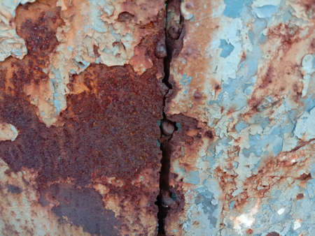 Rusty steel plate is caused by the reaction between oxygen and iron. It is a type of corrosion, moisture and oxygen. 免版税图像