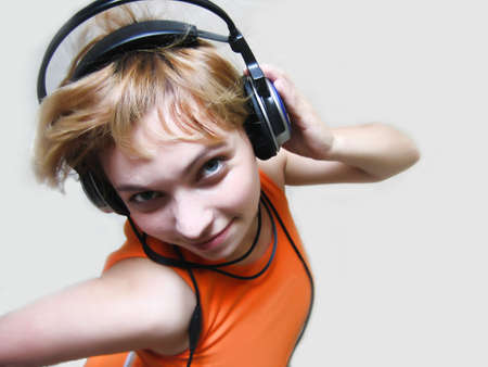 Girl in a headsets isolated on a gray background