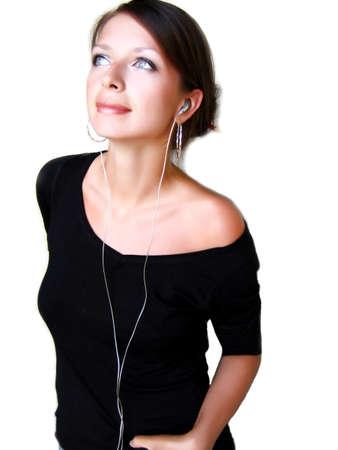 tune: Beautiful girl listening to the music in headphones Stock Photo