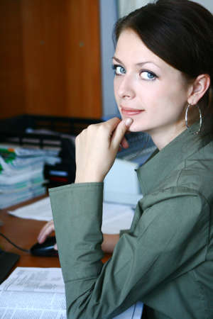 office physical pressure paper: Girl on her workplace working