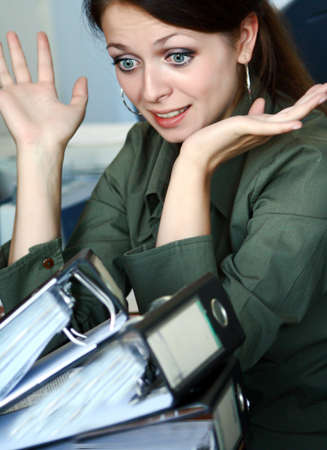 office physical pressure paper: Girl having too much work to do