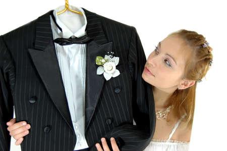 bridegrooms: bride looking at her bridegrooms tail coat