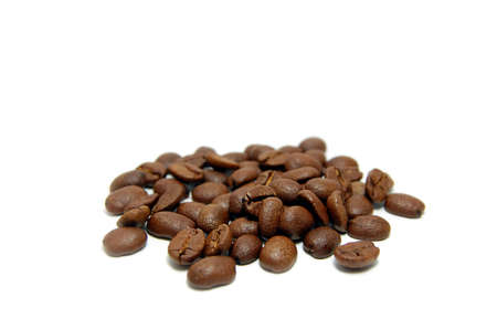 caffiene: Heap of coffee beans isolated on white