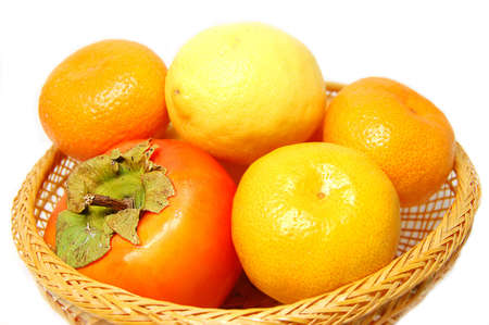 Tangerine,persimmon,lime in wattled basket Stock Photo - 2181121