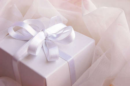 Present white box with silky ribbon in laces Stock Photo