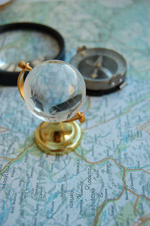 Map, globe and magnifying glass photo