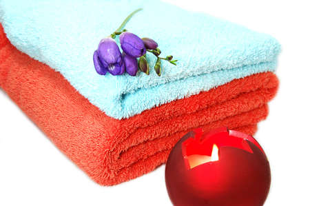 Towels and alight candle, spa relaxation Stock Photo - 2590105