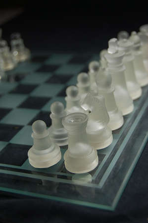 Set of glass chess ready to play photo
