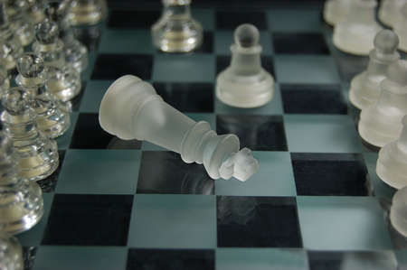 Set og glass chess, king is defeated photo
