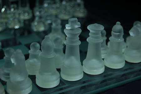 Set of glass chess, ready to play, blue tones photo