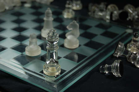Set of glass chess, mat on board photo