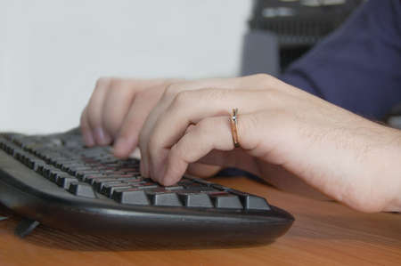 male hand typing on black keyboard Stock Photo - 2730990