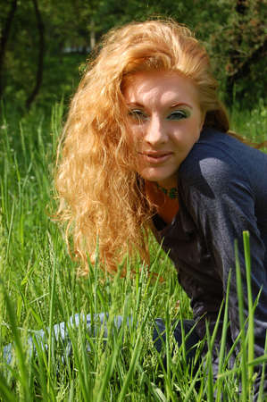 Beautiful redhead girl in green grass Stock Photo - 2983665