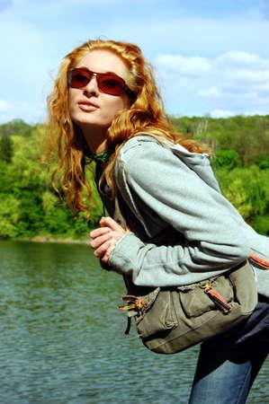 coquettish: Coquettish girl posing on nature background