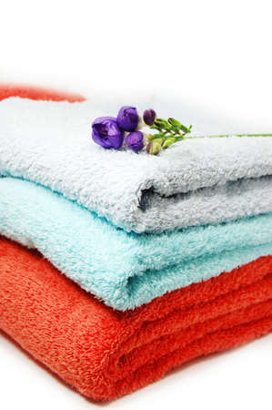 towels in pile and violet flower Stock Photo - 3302027