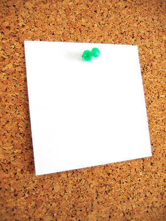 white blank note pind to cork board photo
