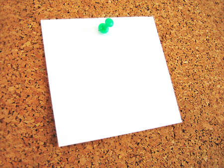 white blank note pined to cork board photo