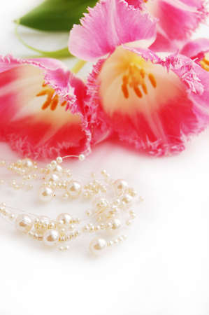 perl: pink tulips and pearlnecklace, engagement concept Stock Photo