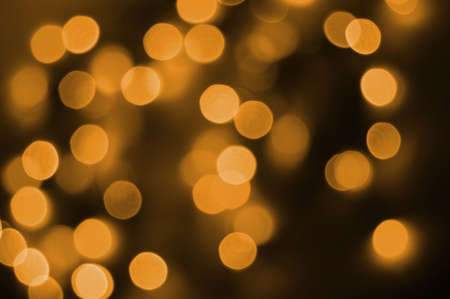 colorful orange abstract holiday lights background Stock Photo