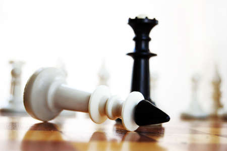 defeat: defeat in chess white king lying on board