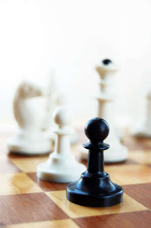 black pawn on chess board photo