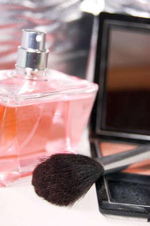 parfum: Brush, powder and pink bottle of parfum