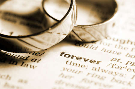 wedding rings near dictionary entry word forever in sepia
