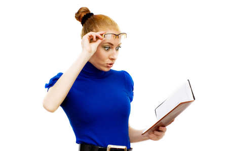 Surprised businesswoman with glasses looking into notebook over white Stock Photo - 4651351