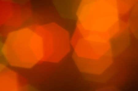 orange bokeh light background in hexagon shape photo