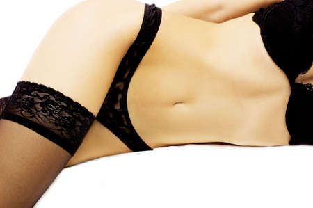 womans: slim womans body in black lingerie with over white Stock Photo