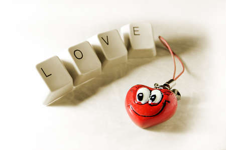 word love from keyboard key and heart photo