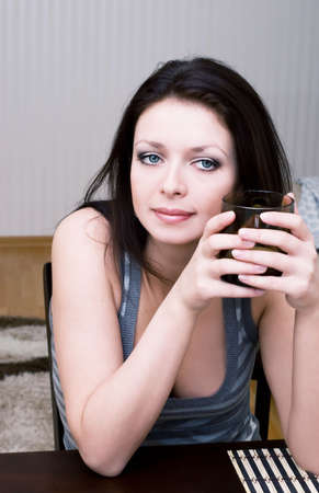 Beautiful brunette drinking tea at home Stock Photo - 4697656