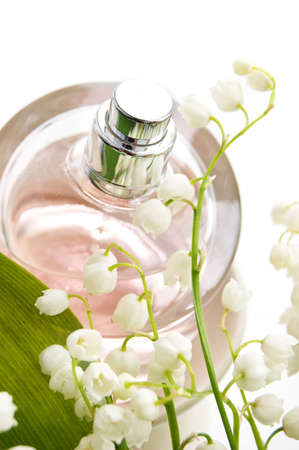 Bottle of perfume and lilies-of-the-valley Stock Photo - 4785716