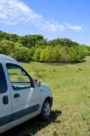 Detail of family car in the fresh green field Stock Photo - 4867332