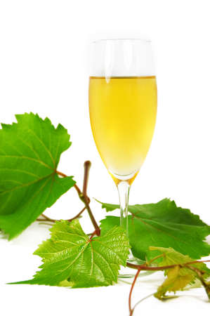 muscat glass of wine with leaves on white photo
