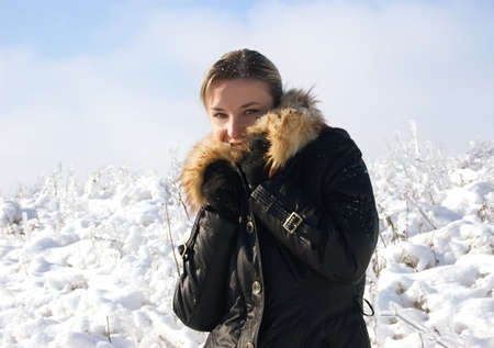 Pretty woman in fur over snowy background Stock Photo - 4941110