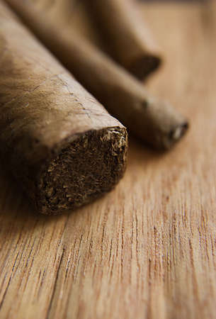 fad: Some cigars over wooden texture, selective focus Stock Photo