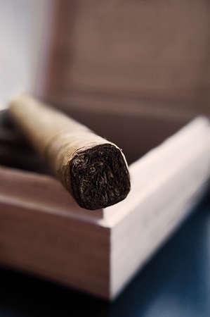 Cigar in a box, selective focus photo