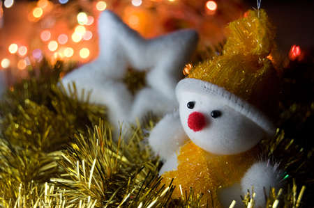 Christmas snowman and star over light background