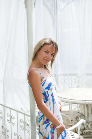 Sensual blonde woman in summerhouse decorated with fabric Stock Photo - 5105029