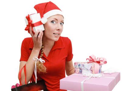 get dressed: Cheerful Santa woman helper shaking gifts Stock Photo