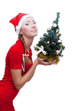 Joyful santa helper with Christmas tree over white photo