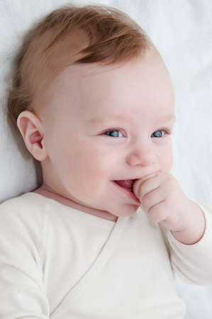 laughing baby: Adorable laughing baby boy over white